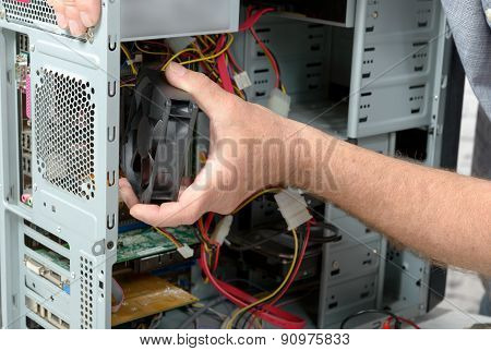 a technician changes the fan of a computer poster