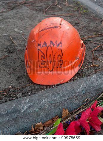 KIEV; UKRAINE - October; 27; 2014: Helmet deceased activist with the emblem and a stylized inscripti