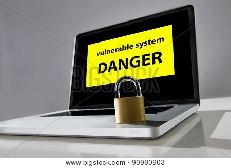locked lock on keyboard of computer laptop with warning message on screen about danger of vulnerable system in cyber crime and hacker attack concept poster