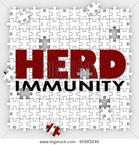 Herd Immunity words on puzzle pieces to illustrate vaccination to protect society or community to be immune from disease or sickness poster