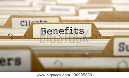 Benefits Concept with Word on Folder.