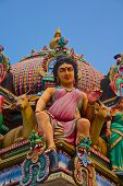 Hindu deity on the roof of the Sri Mariamman hindu temple in Singapore poster