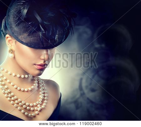 Retro Woman Portrait. Vintage Style Girl Wearing Old fashioned Hat, pearls necklace and earrings, retro Hairstyle and Make-up. Romantic lady over black background. Pearl Jewellery