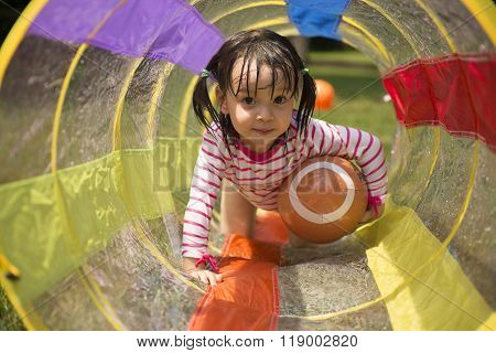 Little Girl Playing In Backyard.