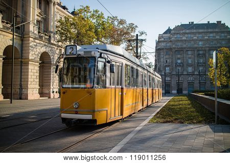 Yellow tram of Budapest at an empty square. Famous tramline number 2.