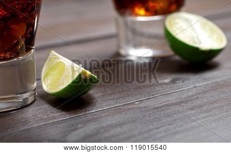 Slice Of Lime With A Cocktail Rum And Cola