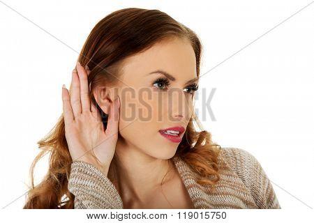Woman overhearing a conversation.