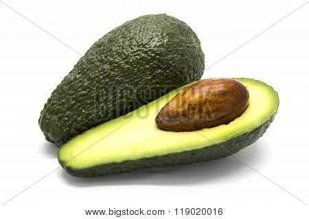 One whole and one sliced avocado on white isolated background