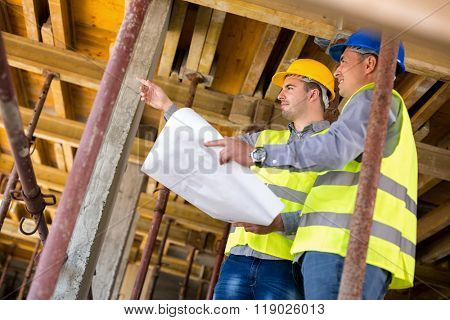 Handsome  architect with supervisor of the construction site show place of build up on construction site