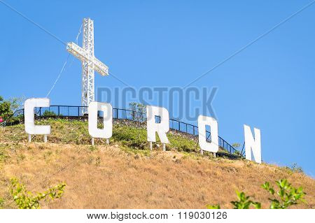 Coron sign with huge white letters on top of mount Tapyas - Main island in Busuanga territory at Calamian archipelago in northern part of Palawan - Philippines natural wonders - Bright morning colors poster