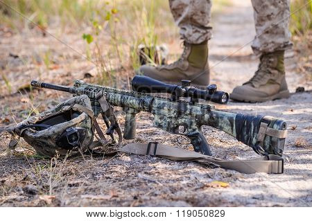 Camouflaged Automatic Rifle With Spotting Scope