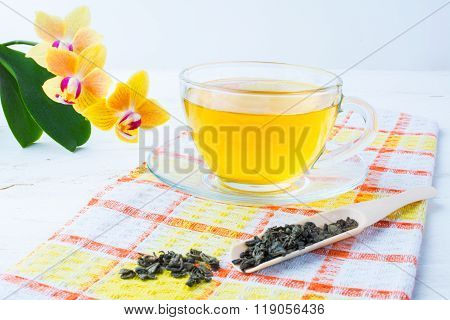 Cup Of Green Tea On Orange Checkered Napkin