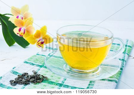 Cup Of Tea On Green Checkered Napkin