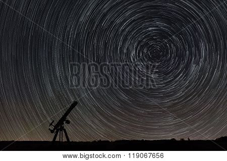 Beautiful night sky, Star trails over filed and astronomical telescope