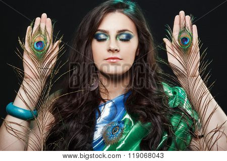 Psychic abilities psychics communicate with spirits. Beauty portrait of girl holding peacock feather