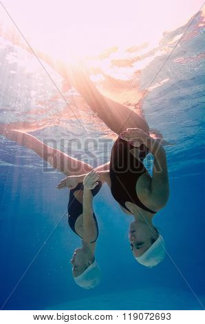 Underwater View Of Synchronized Swimming Duet