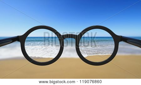 Closeup on eyeglasses with focused and blurred seascape view.