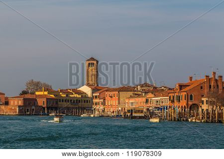MURANO ITALY - 14TH MARCH 2015: Buildings in Murano. A speedboat can be seen coming out of the city