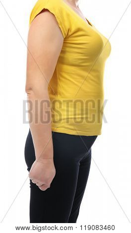 Chubby woman's body in yellow tee-shirt and black pants isolated on white