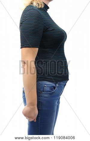 Chubby woman's body in blue tee-shirt and jeans isolated on white