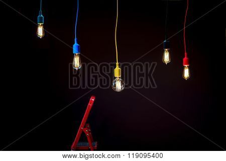 Lamps in colorful plafonds with red ladder