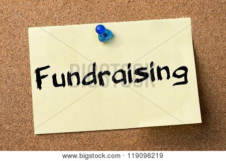 Fundraising - Adhesive Label Pinned On Bulletin Board