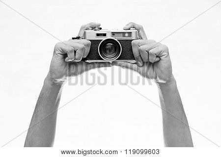 Hands Holding A Wintage Camera Isolated On White
