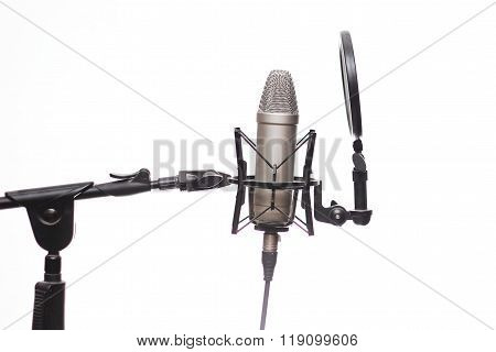 Condencer Mic On Stand In Studio Isolated On White