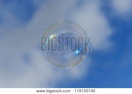 Soap Bubble On Blue Sky