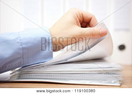 bookkeeper is reviewing invoices and documentation in office