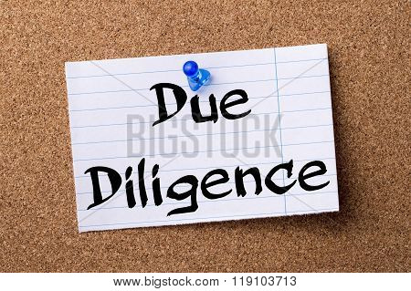 Due Diligence - Teared Note Paper Pinned On Bulletin Board