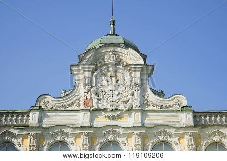 Russian coat of arms on the pediment of the Imperial Palace in farmstead