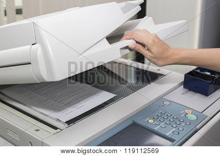 Woman Opening A Photocopier