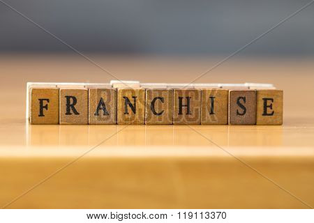 Franchise. Word Written On Wood Block