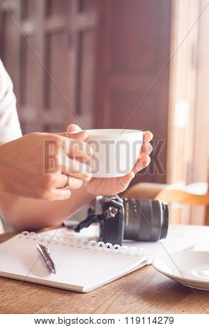 Woman With Cup Of Coffee In Coffee Shop