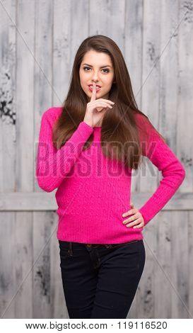 Brunette model woman in sweater in studio