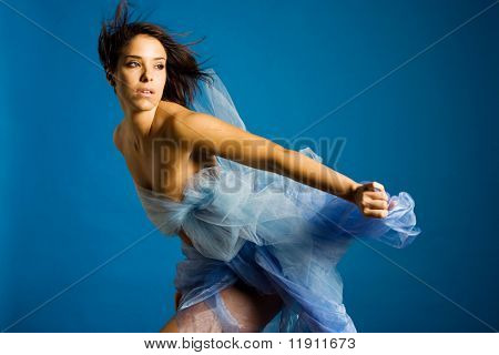 Beautiful woman in silk dancing