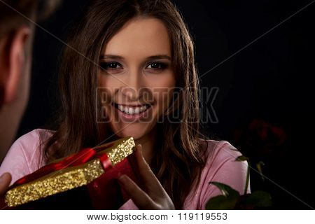 Woman recieving a gift.