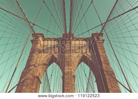 Low Angle Retro Color View of Arch Supports and Suspension Wires of Historic Brooklyn Bridge, Iconic Landmark Connecting Brooklyn and Manhattan, New York City, New York, USA