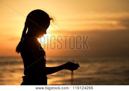 Portrait Of Sad Teenager Girl Standing On The Beach