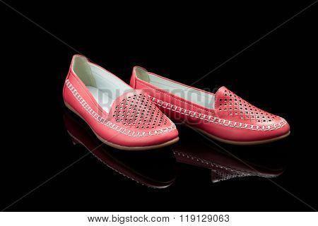Red women loafer isolated on black background