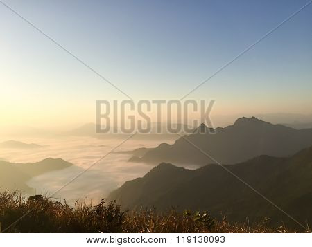 sunrise over the mist in phu chi fah mountain chiang rai Thailand. poster