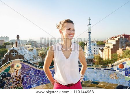 Happy Woman Tourist In Park Guell, Spain Looking Into Distance