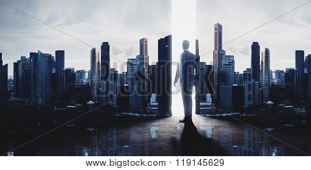 Concept of businessman and skyscrapers. Modern city background. Double exposure, wide