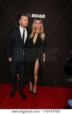 LOS ANGELES - FEB 16:  Aaron Paul, Lauren Parsekian at the Triple 9 Premiere at the Regal 14 Theaters on February 16, 2016 in Los Angeles, CA