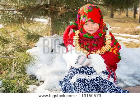 Child Girl In Russian Pavloposadskie Folk Scarf On Head With Floral Print And With  Bunch Of Bagels
