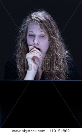 Woman is reading terrible things in the internet poster