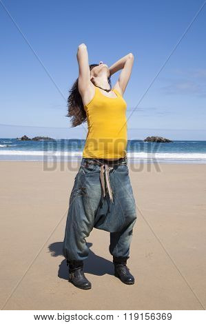 Casual Pregnant Woman At Beach