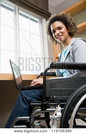 Disabled woman using a laptop computer
