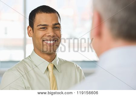 Smiling young man in an interview
